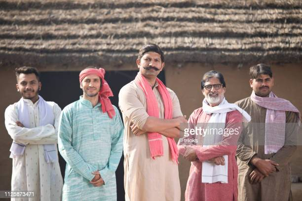 group of farmers at village - village stock pictures, royalty-free photos & images