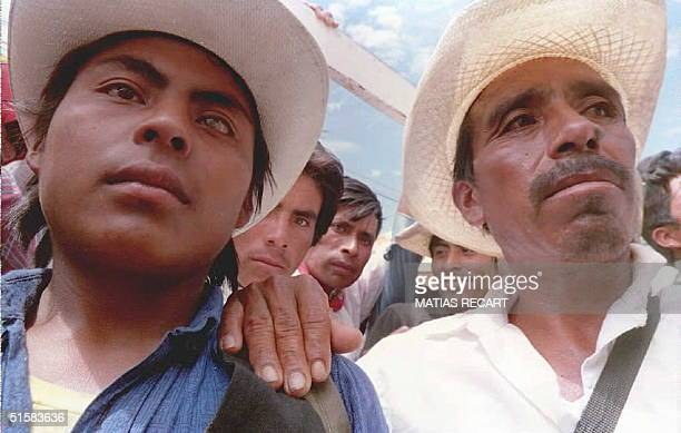 A group of farmers listen to one of their leaders during a rally April 10 infront of the municipal building in Chiapas which has been occupied by...
