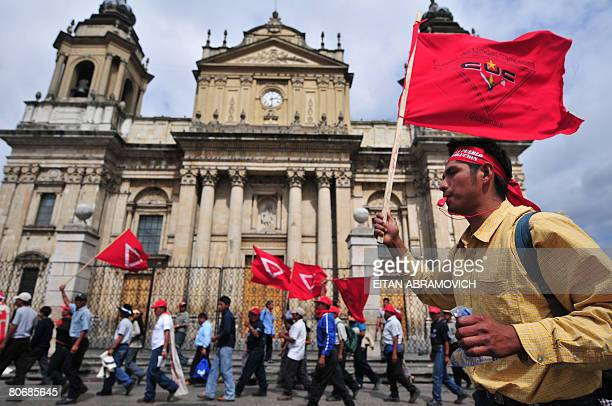 A group of farmers march in front of the Metropolitan Cathedral in Guatemala City on April 15 2008 Thousands of farmers arrived in the capital after...