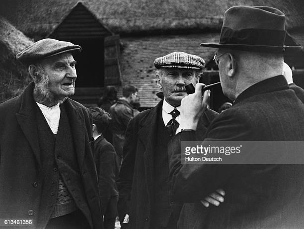 Group of farmers photographed by Bert Hardy.