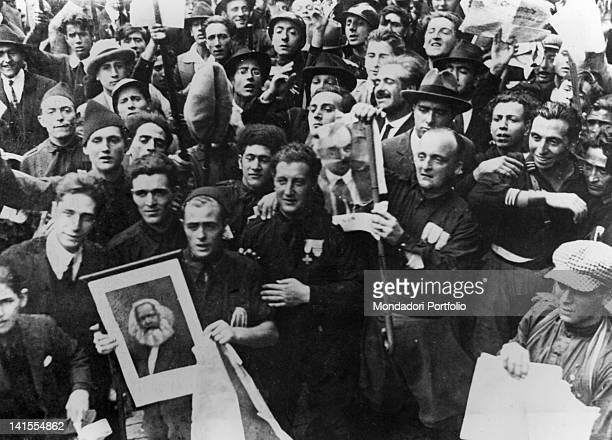 A group of Fascist Blackshirts is about to set fire to portraits of Marx and Lenin during the elections of May 1921 Italy May 1921