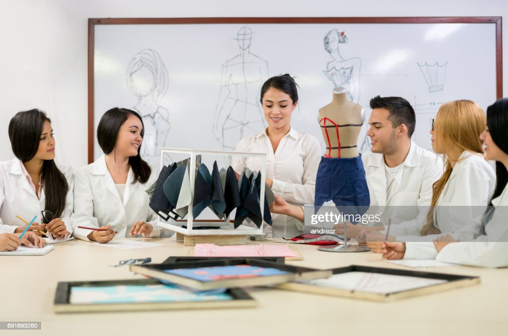 Group of fashion design students in class at the school : Stock Photo
