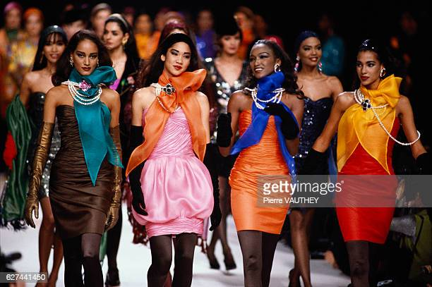 A group of fashion models wears brightly colored readytowear strapless cocktail dresses and scarves by French fashion designer Emanuel Ungaro They...