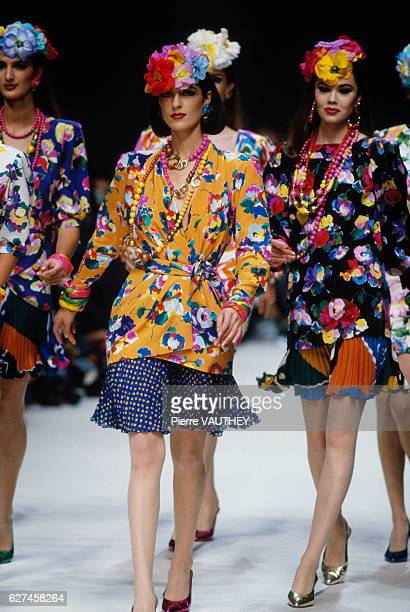 A group of fashion models wears colorful floral print readytowear suits with pleated skirts by French designer Emanuel Ungaro during his SpringSummer...