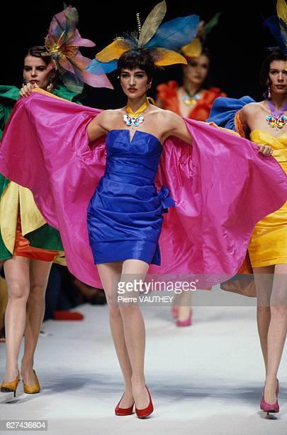 A group of fashion models wears short colorful readytowear cocktail dresses with wraps by French fashion designer Emanuel Ungaro during his...