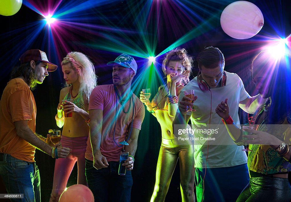 Group of fashionable friends dancing in a club : Stock Photo