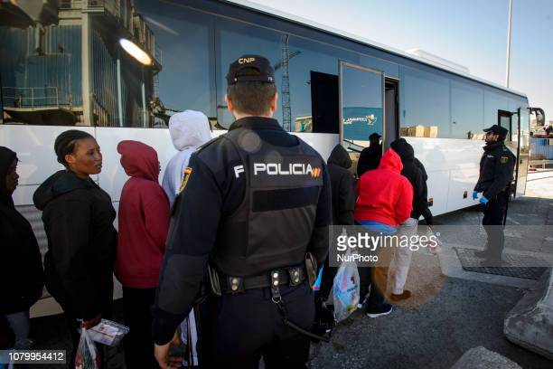 A group of feamle migrants waits to get onto the bus to be transferred toa center on January 9 Malaga Southern of Spain