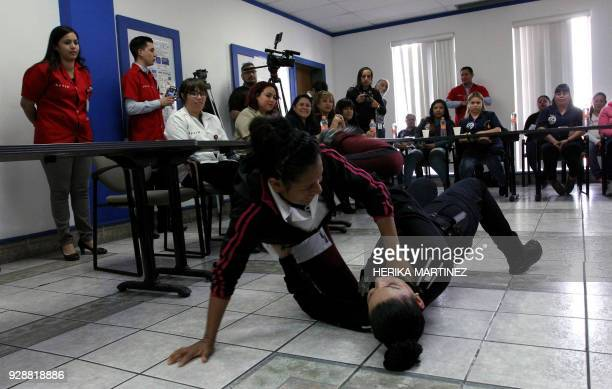 A group of female employees of a 'Maquiladora' attend a selfdefense workshop given by the municipal police on the eve of the International Women's...