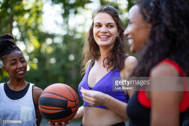 group of female friends after a game of basketball - 30代の女性だけ ストックフォトと画像