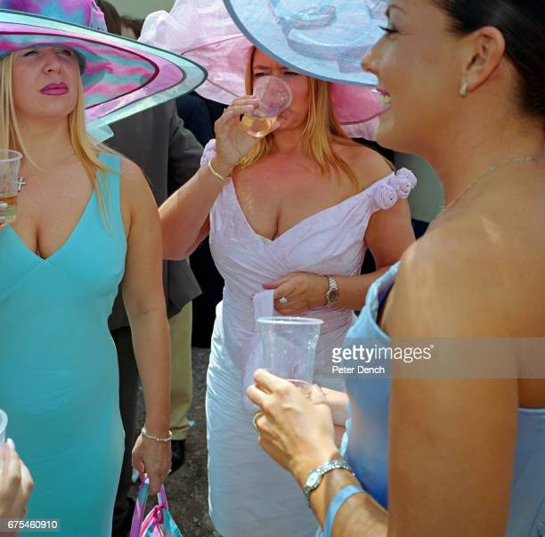 A group of female friends enjoy a drink together on Ladies Day at Royal Ascot June 2002