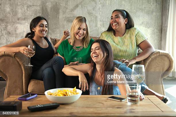 group of female friends having girls night in - night in fotografías e imágenes de stock
