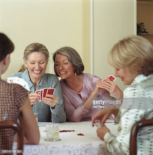 Group of female friends playing cards at table