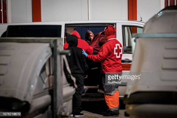A group of female migrants being transferred to a center on 22 December 2018 in Malaga Spain 120 migrants were recued from the danger of crossing the...