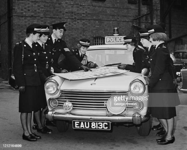 Group of female police cadets learning new road signs during their training at Nottingham City Police Headquarters, 15th October 1965.They are...