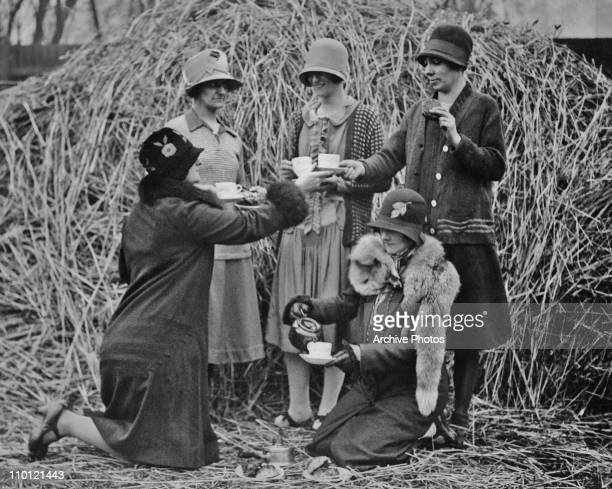 A group of female rugby fans having an alfresco breakfast by a hay rick whilst waiting for the gates to open for an EnglandIreland match at...