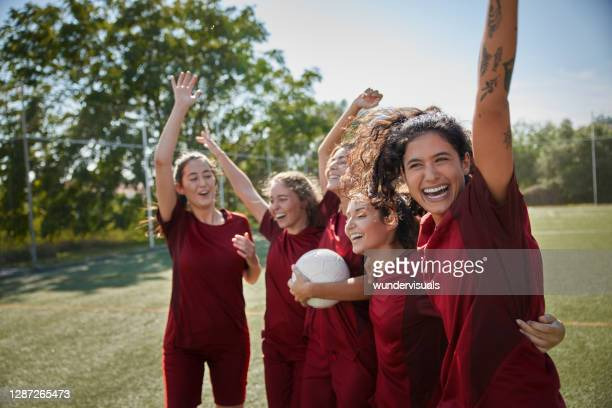 group of female soccer players celebrating goal during match - sports league stock pictures, royalty-free photos & images