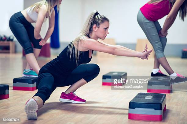 Group of Females Stretching in Gym Before Aerobics Training