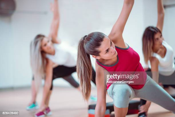 group of females stretching in gym before aerobics training - manufactured object stock pictures, royalty-free photos & images