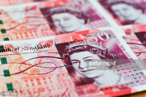 group of fifty pound notes background - number 50 stock pictures, royalty-free photos & images