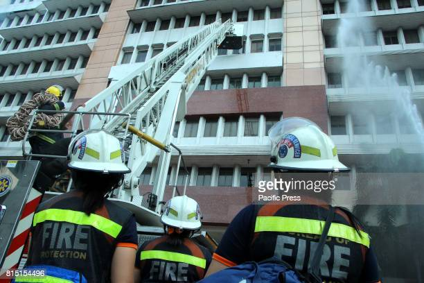 A group of fire fighters trying to control the fire at Quezon City Hall Building during the Manila Earthquake Drill in Quezon City The Nationwide...