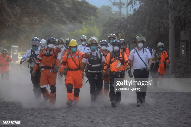 A group of firefighters enter the area affected by volcanic eruption in Alotenango Guatemala on June 05 2018 At least 69 people have been killed and...