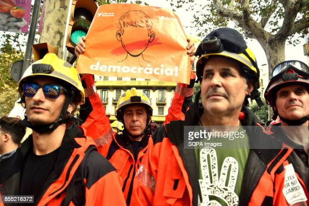 A group of firefighters from the Government of Catalonia are seen holding a banner with the slogan of democracy Around 15000 students gathered to...