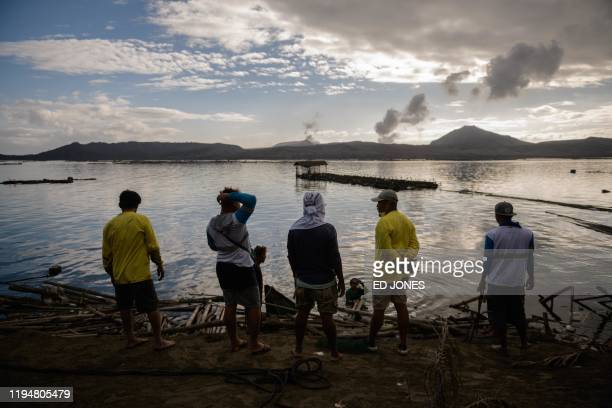 TOPSHOT A group of fishermen make repairs to their operations affected by the ashfall from the eruption of the Taal volcano in Buso Buso on January...