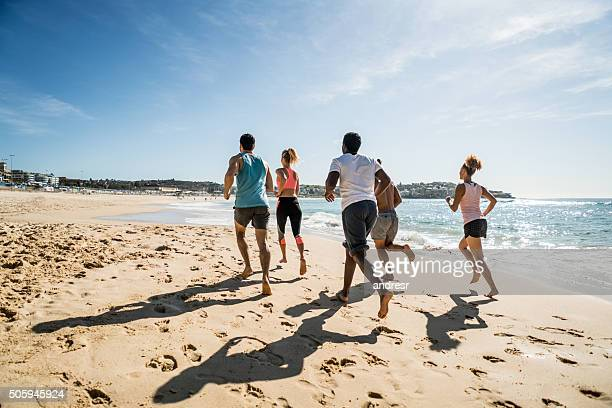 Group of fit people running at the beach