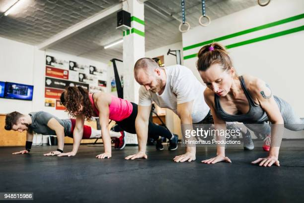 Group Of Fitness Enthusiasts Working Out