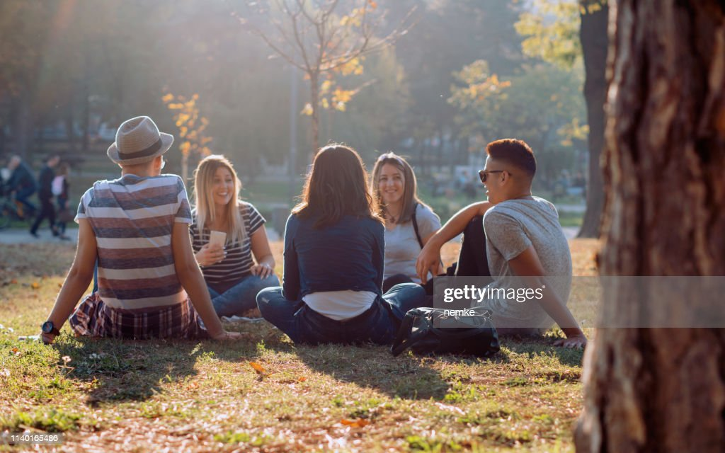 Group of five friends laughing out loud outdoor, sharing good and positive mood : Stock Photo