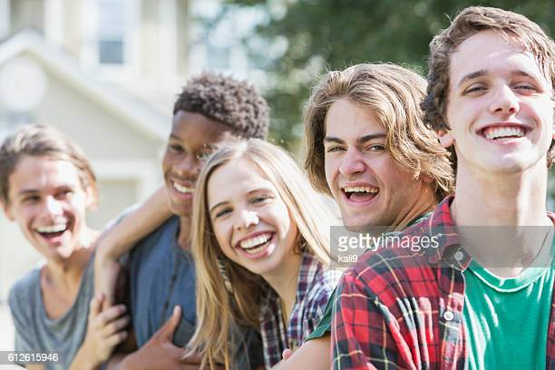 Group of five multi-ethnic teenagers hanging out