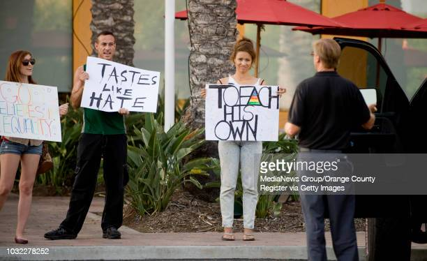 A group of five protestors outside the ChickfilA in Tustin speak with customer as he leaves the restaurant INFORMATION chickfilakiss Ð 8/3/12 Ð...