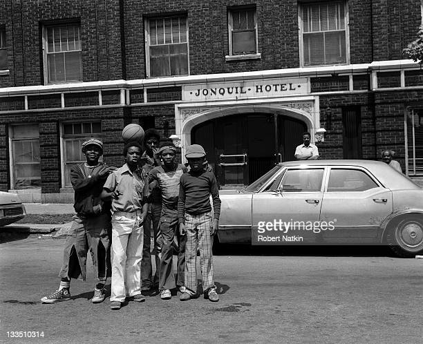 A group of five young African American teenagers stand in front of the Jonquil Hotel at 1600 W Jonquil Terrace in the Rogers Park neighborhood of...