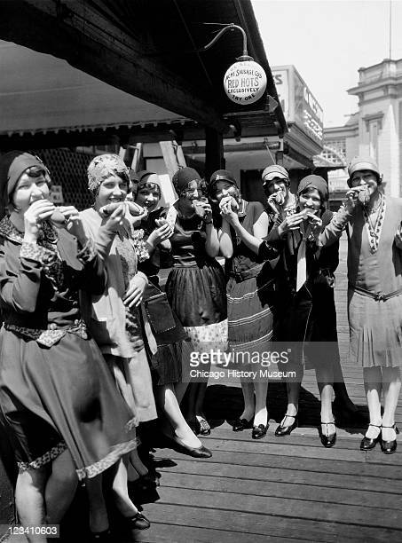 A group of flappers enjoy hot dogs at White City amusement park Chicago IL 1925