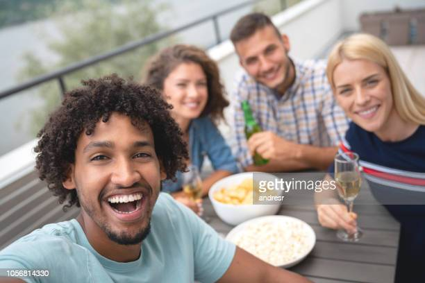 Group of flat mates having fun at home and taking a selfie
