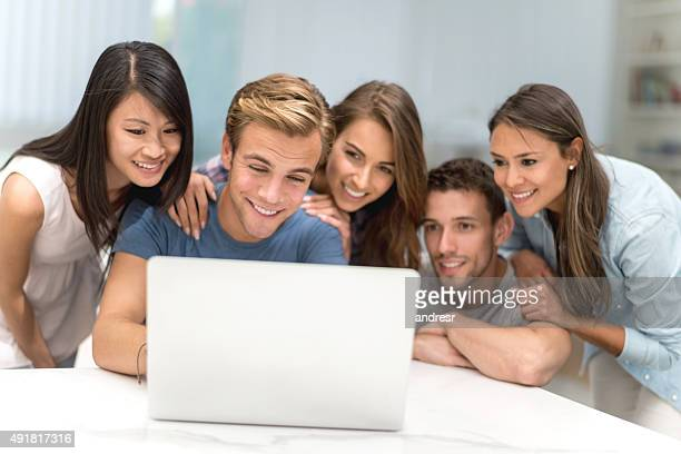Group of flat mates online on a laptop