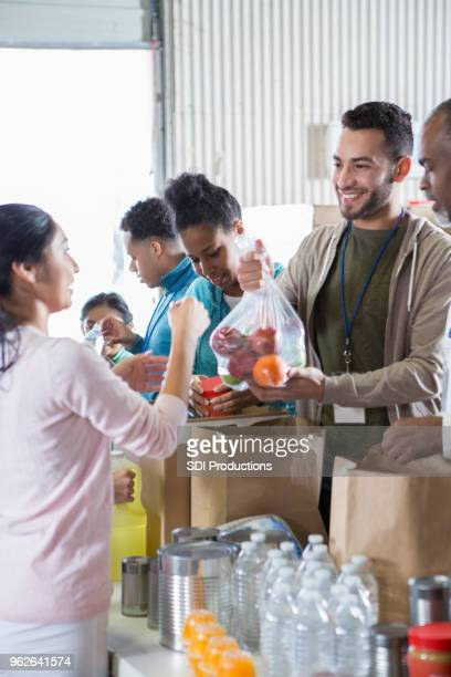 Group of food bank volunteers accept and organize donations