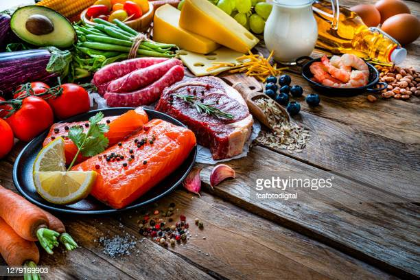group of food containing carbohidrates, protein and dietary fiber shot on wooden table. - fat nutrient stock pictures, royalty-free photos & images