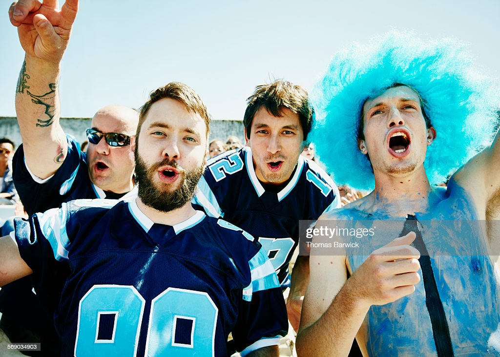 Group of football fans yelling in stadium : Stock Photo
