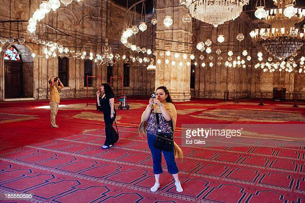 A group of foreign tourists take photographs inside the Muhammad Ali Mosque in Cairo's Citadel on October 21 2013 in Cairo Egypt The Muhammad Ali...