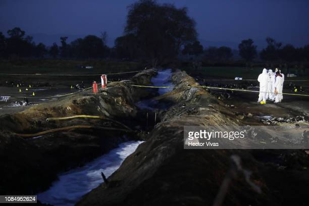 A group of forensic doctors work along the pipeline after an explosion in a pipeline belonging to Mexican oil company PEMEX on January 19 2019 in...
