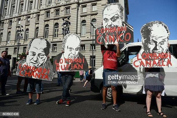 A group of former employees of the Kirchner Cultural Centre hold portraits of Hernan Lombardi head of the Sistema Federal de Medios y Contenidos...