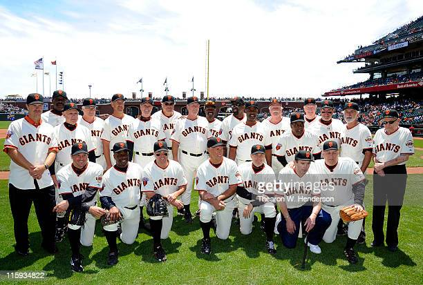 A group of former San Francisco Giants players get together for a group photo after playing in the Giants Legends game before a MLB baseball game...