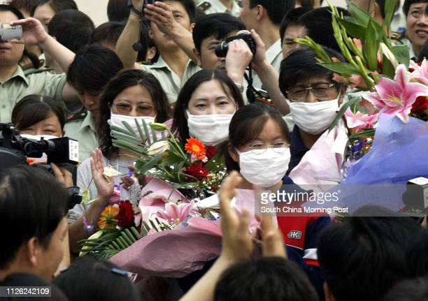 A group of former SARS patient upon thier release from the Xiaotangshan SARS hospital in the north of Beijing They are amongst a group of 18 patients...