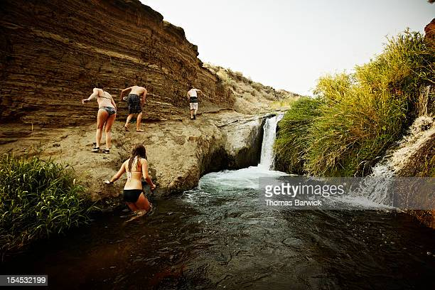 Group of four friends walking out of swimming hole