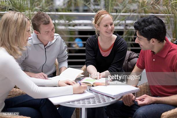 Group of four multi-ethnic students in teamwork