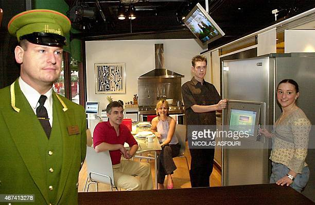 A group of four people from left Carl Newman Sarah Wooster Steve Wilson and Charlie Parker poses 20 May 2002 in the locale where the four will live...