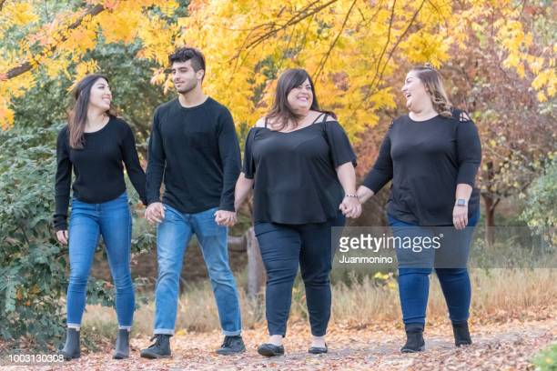 group of four people hanging out together - arab women fat stock pictures, royalty-free photos & images