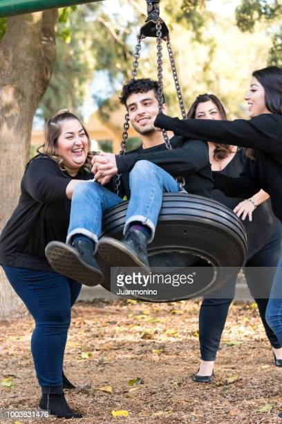 Group of four people hanging out together