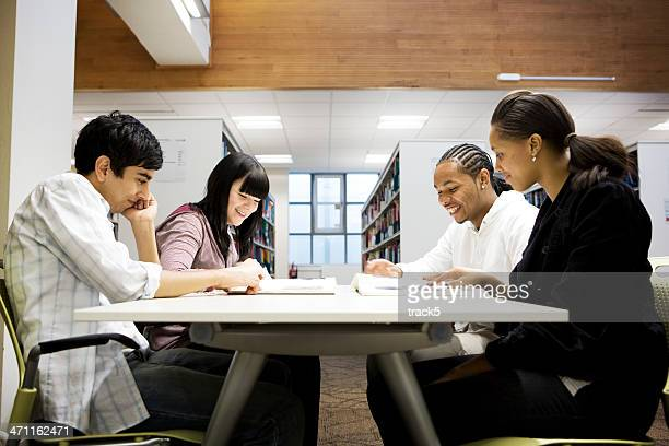 Group of four students studying at a desk together